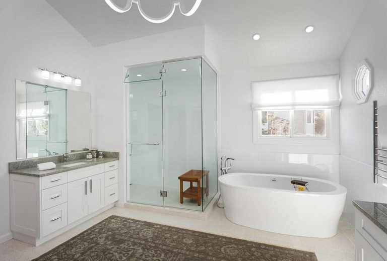 Clean white master bathroom remodel