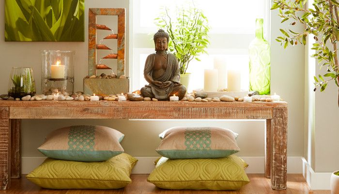 Buddha on table with pillows and shrine
