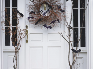 Home entryway decorated with Halloween decor